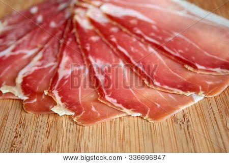 Prosciutto Ham  Sliced Prosciutto On A Wooden Board