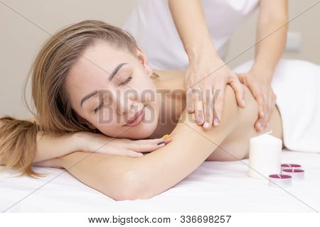Massage And Body Care. Spa Body Massage Woman Hands Treatment. Woman Having Massage In The Spa Salon