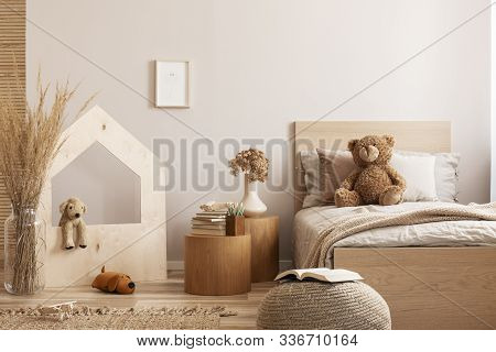 Beige Kid's Room With Wooden Nightstand With Flowers And Books And Single Bed With Teddy Bear