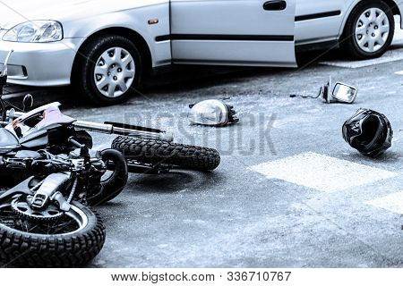 Motorcycle And Car After Terrible Accident On The Road