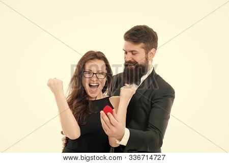 Long awaited proposal. Couple celebrate anniversary relations. Hope she likes ring. Proposal of marriage concept. Man hold little red box romantic proposal. Will you marry me. About to say yes. poster