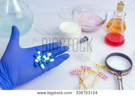 Food Inspector Holds Pills In The Palm Of His Hand. Laboratory Food Quality Control. Check For Addit