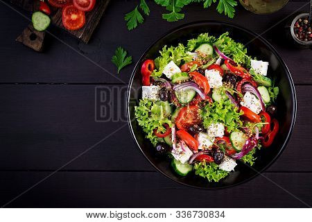 Healthy Food. Greek Salad With Cucumber, Tomato, Sweet Pepper, Lettuce, Red Onion, Feta Cheese And O