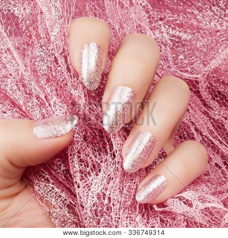 Female Hand With Glittered Shiny Rose Nails Is Holding A Glittered Rose Lace, Nail Care And Manicure