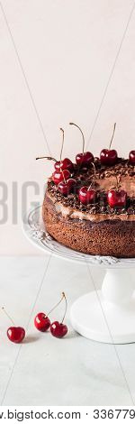 Chocolate Cake On A Cake Stand Decorated With Chocolate Shavings And Sweet Cherries, Banner, Copy Sp