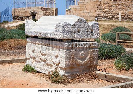 The stone roman Sarcophagus in antique Caesarea. Israel. poster