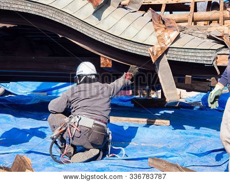 Aso, Japan - November 5, 2016: Debris Being Carefully Cleared By Workers In Heavily Damaged Aso Shri