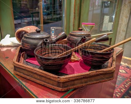 Traditional Cute And Cozy Zen Like Set For Tea Drinking, Wooden Pot, Cups And Spoons On A Plate, Cal