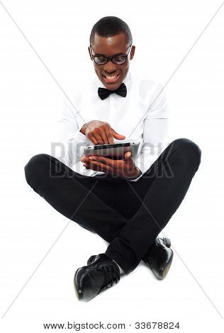 African Boy Watching Video On Tablet Pc