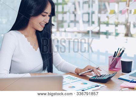 Financial Adviser Use Calculator To Calculate Revenue & Budget. Accountant Doing Accounting. Bookkee