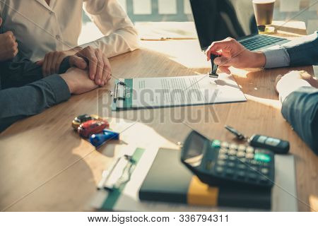 Real Estate Agent Dealer Salesman Using Stamper For Stamping Approved On Mortgage Loan Auto Insuranc