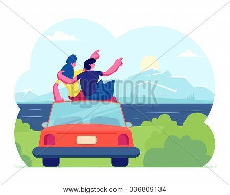 Happy Loving Couple Travel Together. Man And Woman Sitting On Roof Of Car Hugging And Looking On Sun