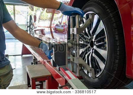 Wheel Alignment ,grid Sensor Sets Mechanic On Auto. Car Stand With Sensors Wheels For Alignment Camb
