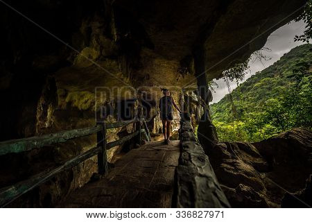 Dong Trung Trang Cave Vietnam Tourist Backpacker Exiting The Cave
