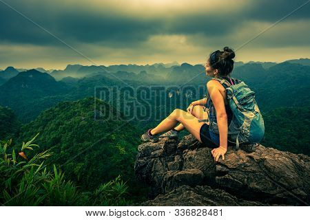 Tourist In Vietnam Backpacker Enjoys The View Of The Cat Ba National Park From The Viewpoint