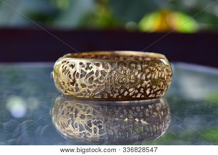Gold Bangles It Is Beautiful Gold And Has An Expensive Bracelet Pattern.