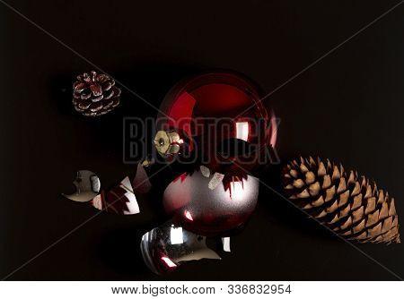 A Broken Christmas Decoration On A Black Background