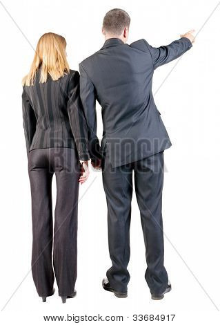 Back view of  pointing business team. young couple in suit (man and woman) .   Rear view people collection.  backside view of person.  Isolated over white background.