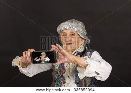 Vintage Woman In Glitters With Smart Phone
