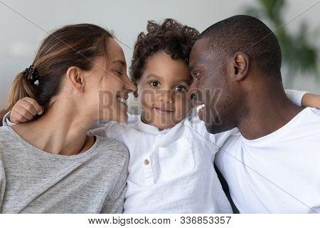 Happy Mixed Race Family Bonding Head Shot Close Up Portrait.
