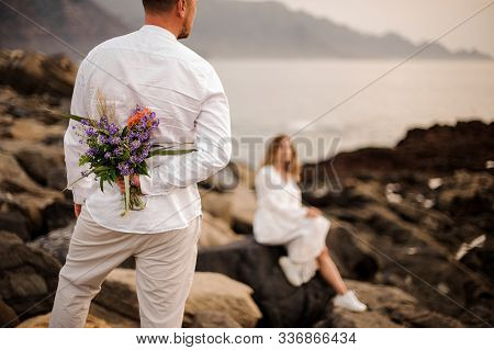 Man Going To Give A Bouquet To His Fiancee