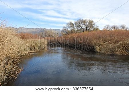 Scenic Owens River Flowing Through The Autumn Foliage, Eastern Sierra Nevada Mountains, Owens Valley
