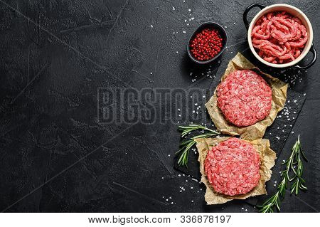Ground Raw Meat Patties. Meat Patties Ready To Cook. Barbecue Party. Farm Organic Meat. Black Backgr