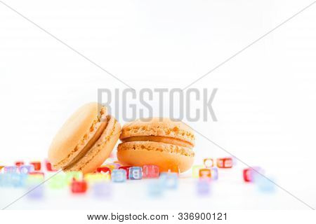 Macaroons With Colorful Cube Letters On White Background Top, Color Macaroons, Selective Focus