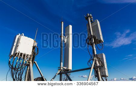 Telecommunication Masts With Microwave, Radio Panel Antennas, Outdoor Remote Radio Units, Power Cabl