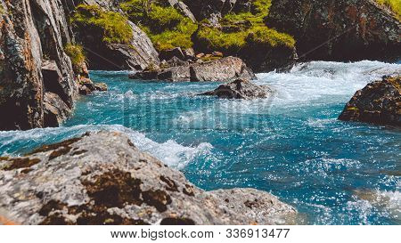 Turquoise Water In River With Stone Shore. Sea Tide, Seething Blue Water In Mountain Stream