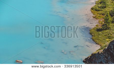 Sea Bay With Stone Shore, Turquoise Lake In Rocks, Mountain River With Blue Water