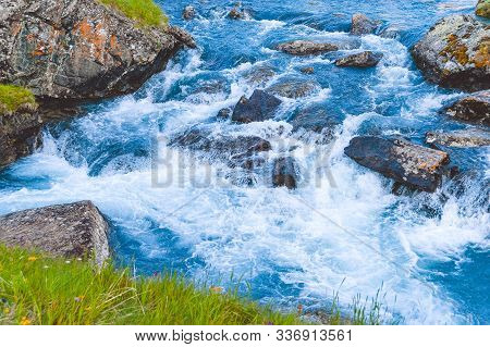 Rough River Flow. The Blue Water Of Mountain River, The Tide On Sea With Turquoise Water And Stone B