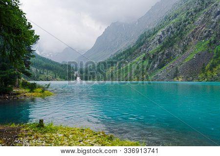 Turquoise Lake Among Rocks. Mountain Pond For Hiking