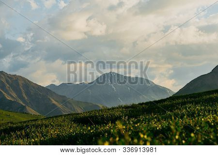 Green Hills Under Blue Cloudy Sky. Mountain Valley For Pasture