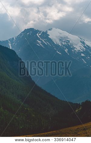 Mountain Range Under Clouds. Rocks For Hiking And Tourism