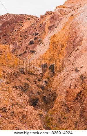 Rocks In Canyon Of Dry River Bed. Drought Due To Climate Change. Soil Erosion Of Hills. Red Sand In