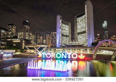 Toronto, Canada - September 20, 2019: Nathan Phillips Square At Night With Toronto Sign And City Hal