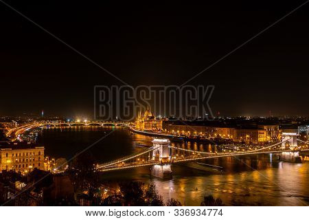 Budapest Nightscape, View Over Bridges And Parliament Building.