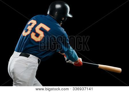 Batter Hitting A Ball. Back View Portrait On A Baseball Player