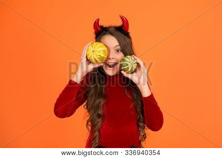 November Holidays And Fun Days. Happy Child With Red Demon Horns Hold Pumpkins. November 1. All Sain