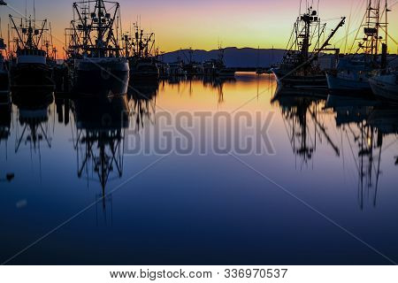 Bellingham, Wa Marina With Pacific Northwest Salmon Fishing Boats In The Harbor At Twilight