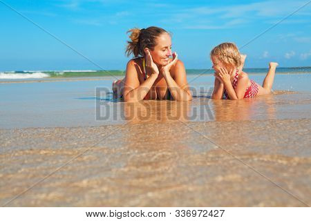 Happy People Have Fun In Sea Surf On White Sand Beach. Young Mother With Child Lying In Water Pool.