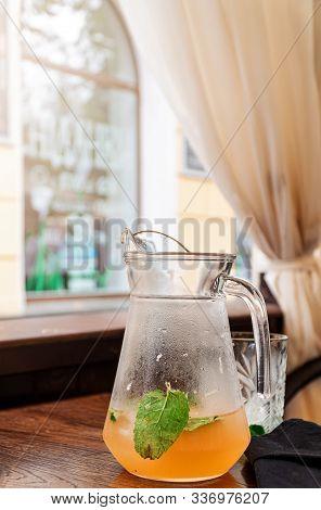 Orange Juice Lemonade In Glass Jar With Mint Leaf. Summer Detox Dit In Restaurant. Outdoors