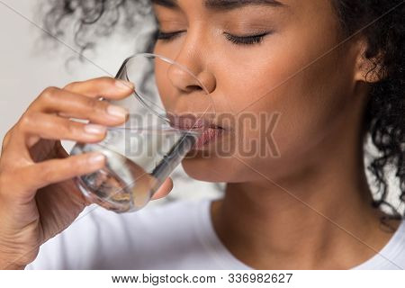 Thirsty African American Woman Drinking Clean Mineral Water Close Up