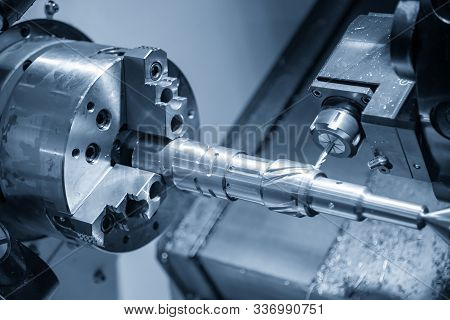 The Multi-tasking Cnc Lathe Machine Cutting The Automotive Parts By  Milling Spindle  With The Cutti