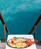 plate with lobster with view on ocean poster
