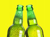two beers making a toast on yellow backgroound poster