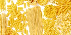 Italian Pasta Texture Panorama, A Flat Lay Banner, Shot From The Top On A White Background. Fusilli,