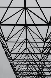 Metal Sections Of The Roof Of An Industrial Warehouse. View From The Bottom Up. Shooting On A Backgr