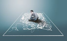 Thoughtful Man Sitting Inside A A Square, Drawn With Messy And Chaotic Lines. The Concept Of Mental